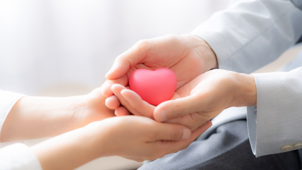 people holding heart symbol